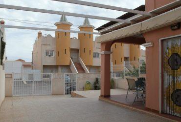 Duplex semiadosado con parcela, vistas al mar y piscina comunitaria en venta en Puerto de Mazarron #10307