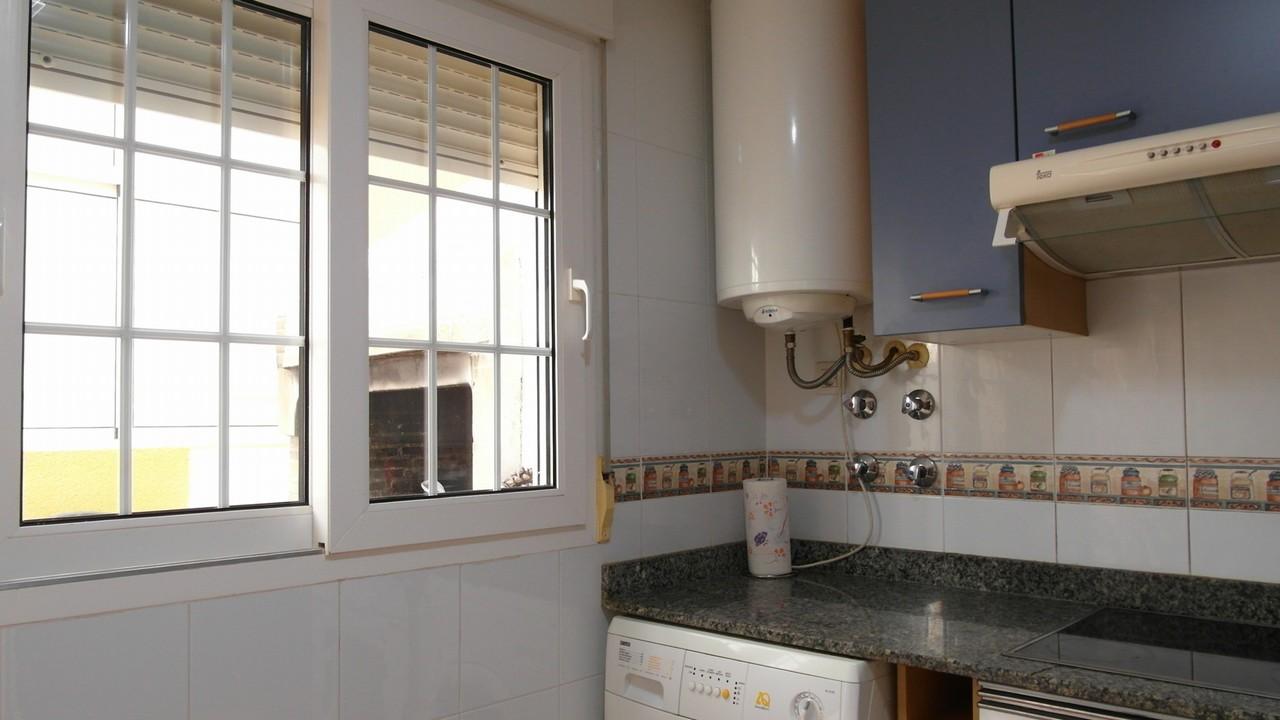 Duplex adosado y coqueto, con A/A, piscina y vistas al mar en venta en Isla Plana