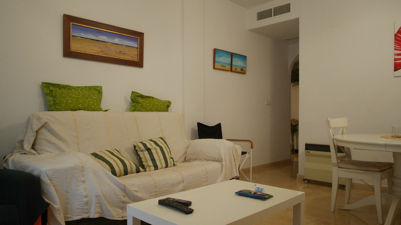 Downtown apartment, patio and parking space with storage room for sale in Puerto de Mazarron